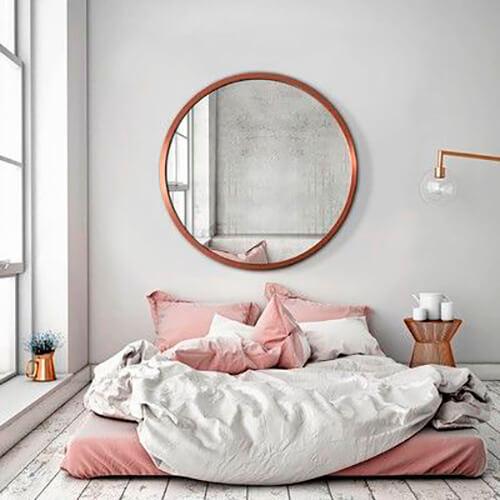 decorar uma apartamento alugado - espelho redondo no quarto